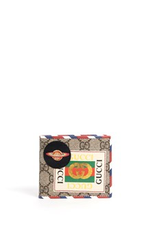 GUCCI classic wallet with gucci logo printed all over and patches