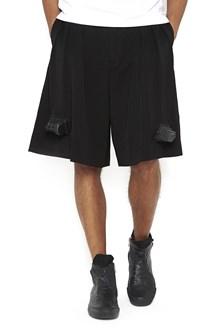 COMME DES GARÇONS HOMME PLUS wool bermuda shorts with applications